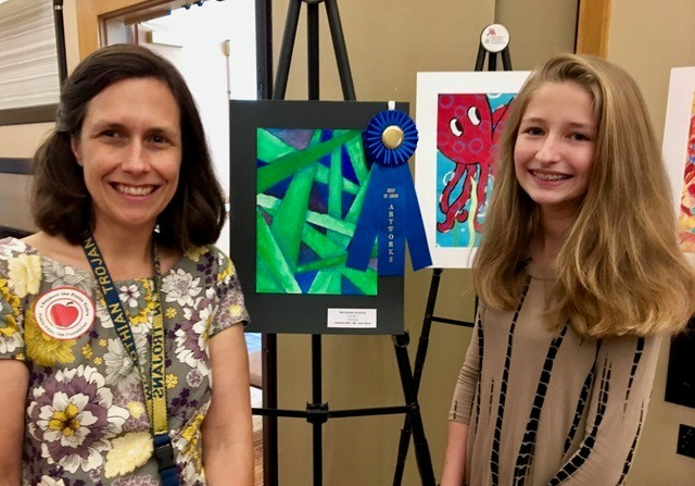 Landrum Middle School student Mackenzie Leverock stands alongside art teacher Jennifer Meyer after winning Best in Show.