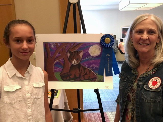 PVPV-Rawlings Elementary School student Leila Festic stands alongside art teacher Barbara Stroer after winning Best in Show.