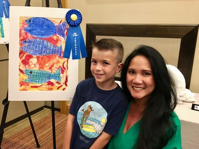 PVPV-Rawlings Elementary School student Maximilian Gomez stands alongside art teacher Kim Scribner after winning Best in Show.