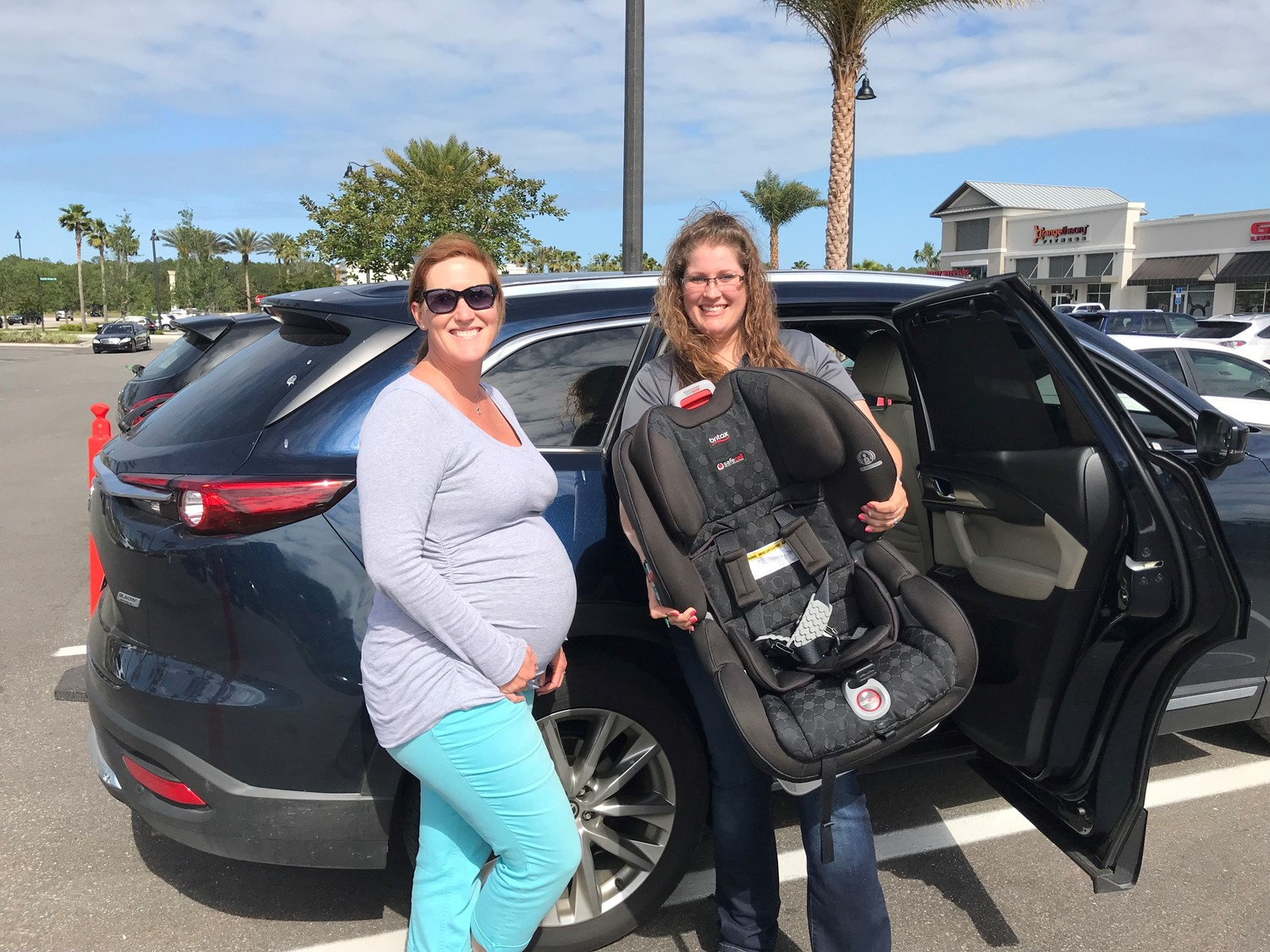 Nocatee resident Kristen Paige and St. Johns County Tax Collector Office employee Vanessa Suarez pose for a photo at the May 2 car seat safety check hosted by REMAX Unlimited.