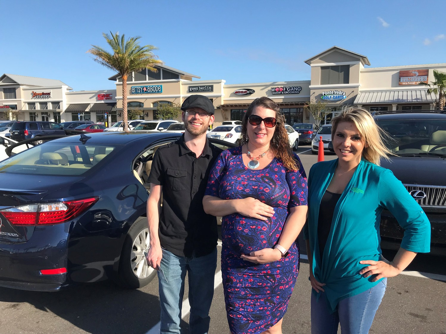 Nocatee residents Jonathan and Stephanie Feland (from left) gather with St. Johns County Tax Collector Office employee Whitney Graves at the May 2 car seat safety check hosted by REMAX Unlimited.