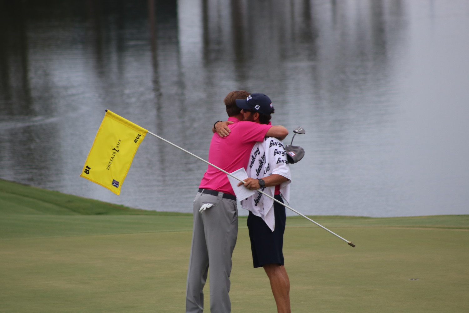 Webb Simpson embraces his caddie, Nocatee resident Paul Tesori, after winning THE PLAYERS Championship 2018.