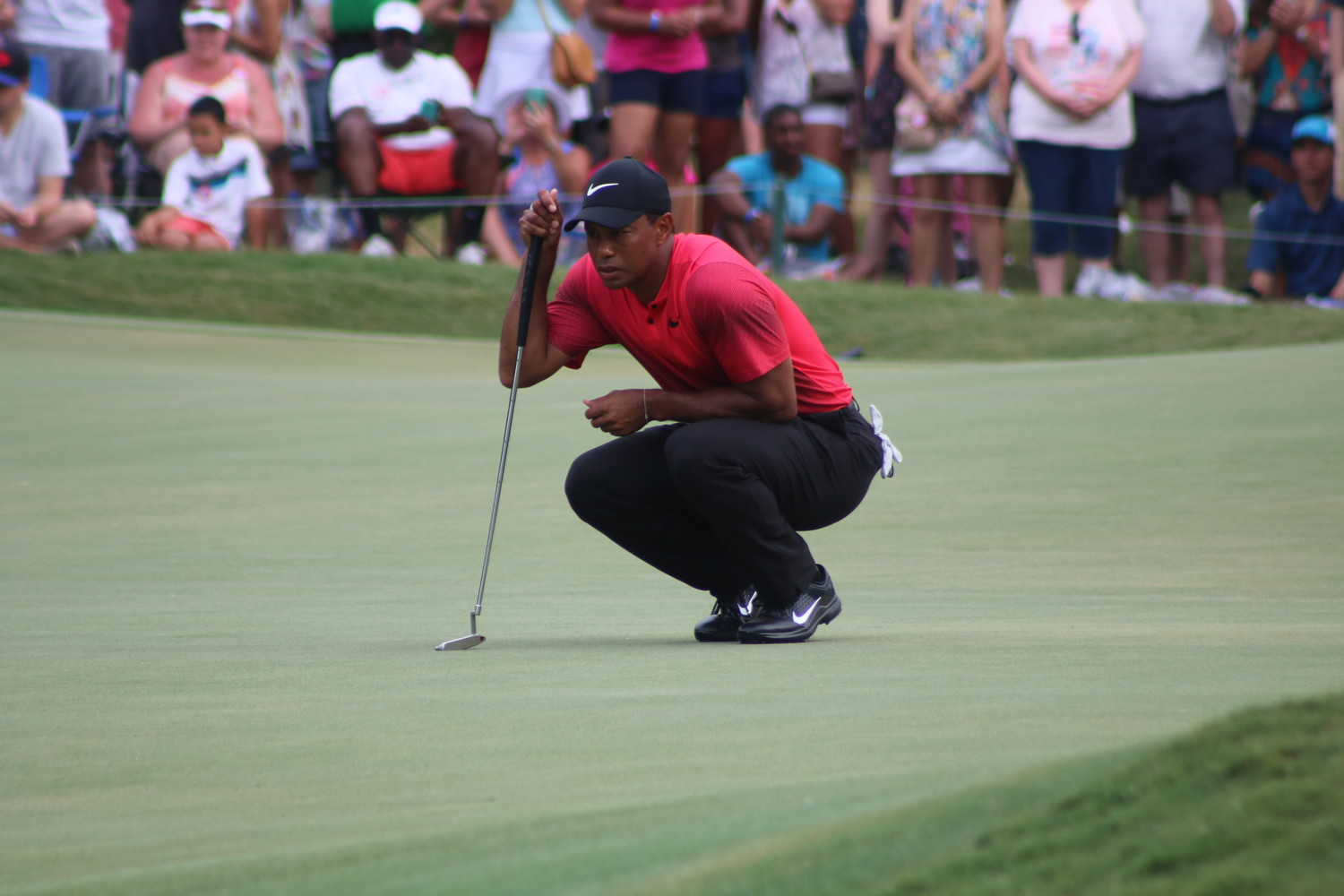 Tiger Woods eyes up a shot at THE PLAYERS Championship 2018 in Ponte Vedra Beach.