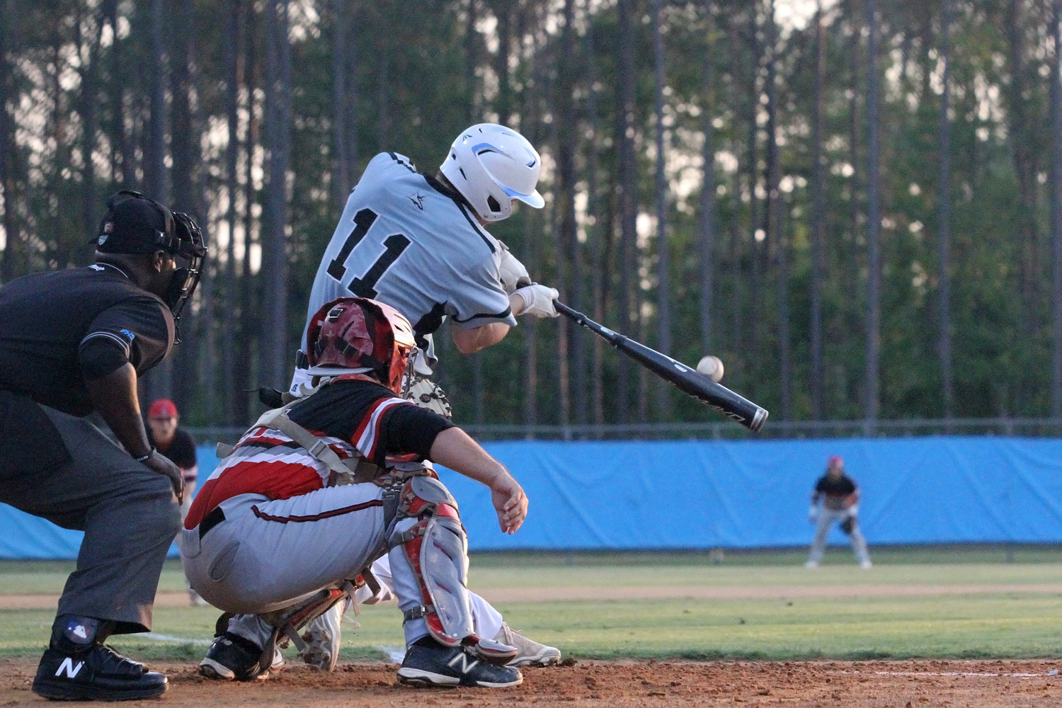 Jacob Young of the Sharks drives the ball to deep left field.