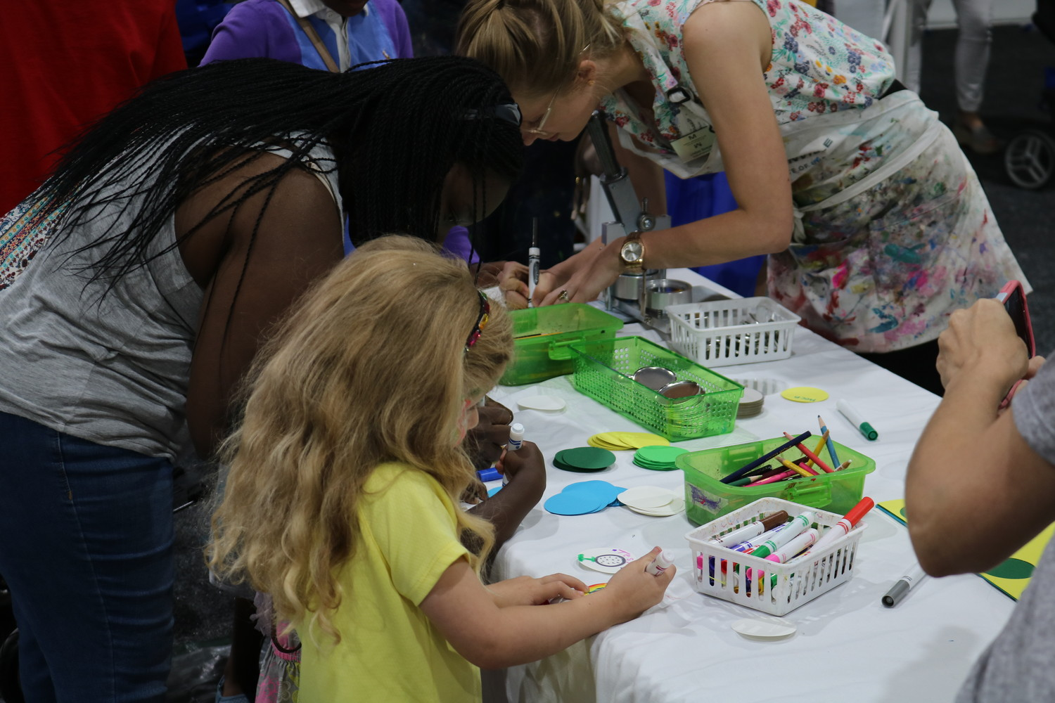 Children and some adults enjoy coloring at the Community PedsCare event.