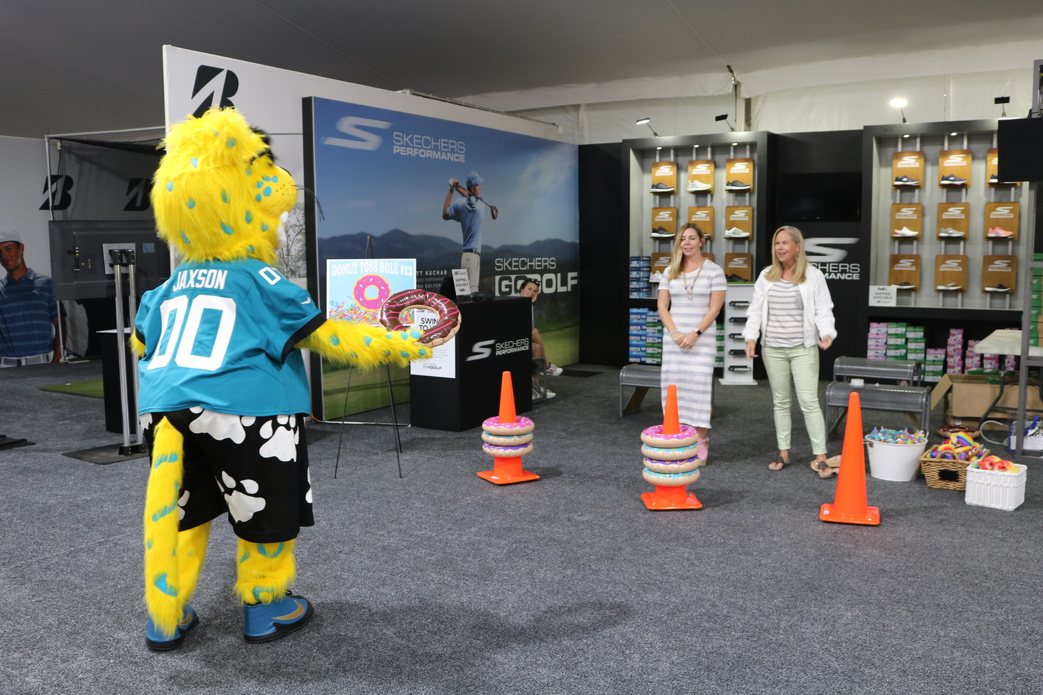 Jaguars mascot Jaxson De Ville tosses inflatable donuts in front of the Sketchers booth.