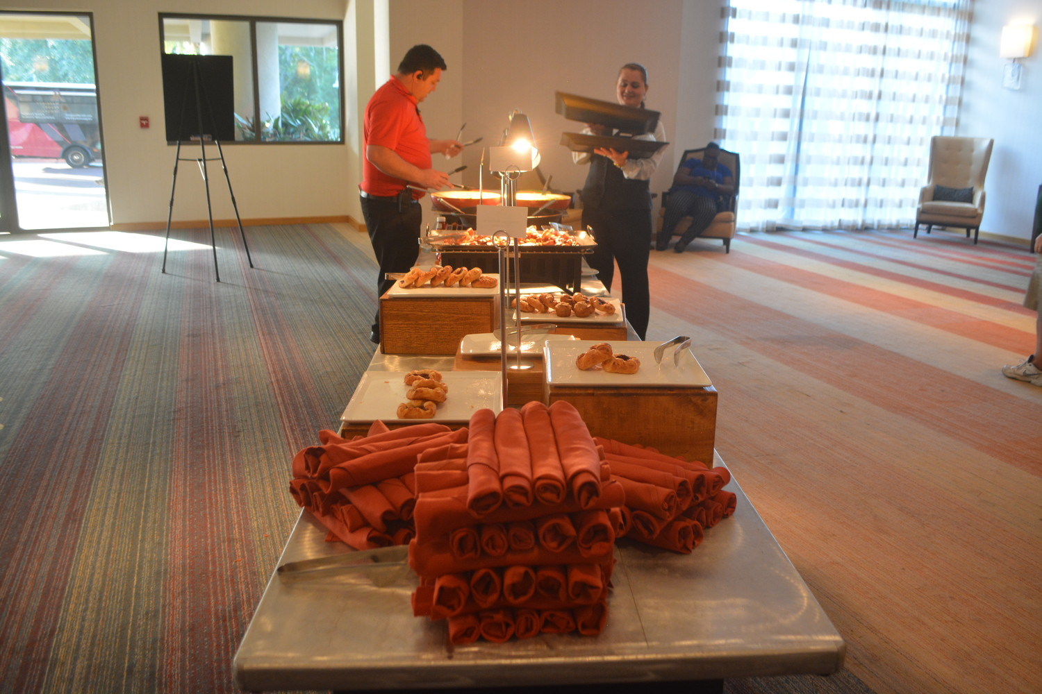 A breakfast buffet is set up for event attendees.