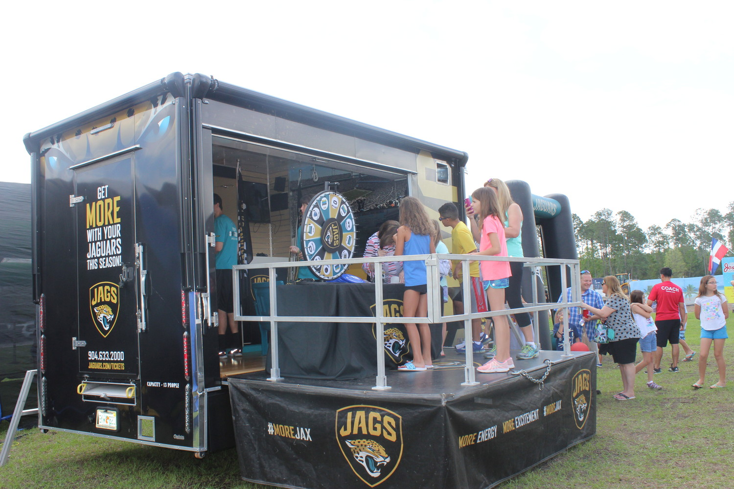Nocatee Farmers Market guests enjoy the Jaguars rally.