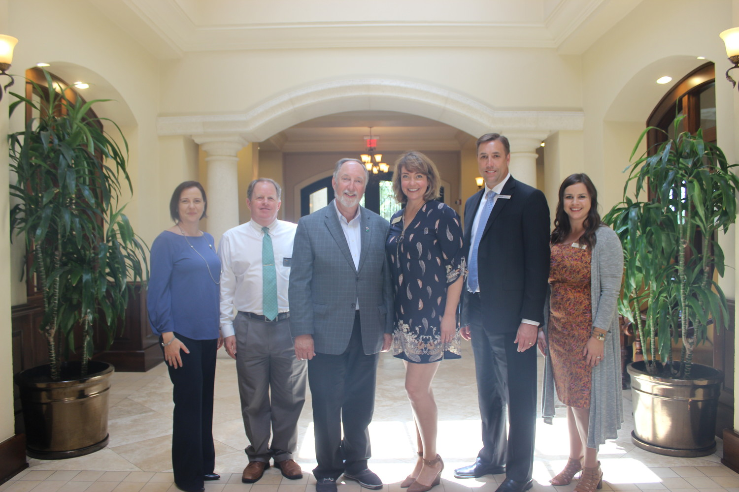 "Isabelle Rodriguez-Renault, Rob Schlingmann, Dr. Tony Parker, Toni Boudreaux, Brian Zehren and Brittany Wynne gather after the ""Chamber at Noon"" event on May 23."