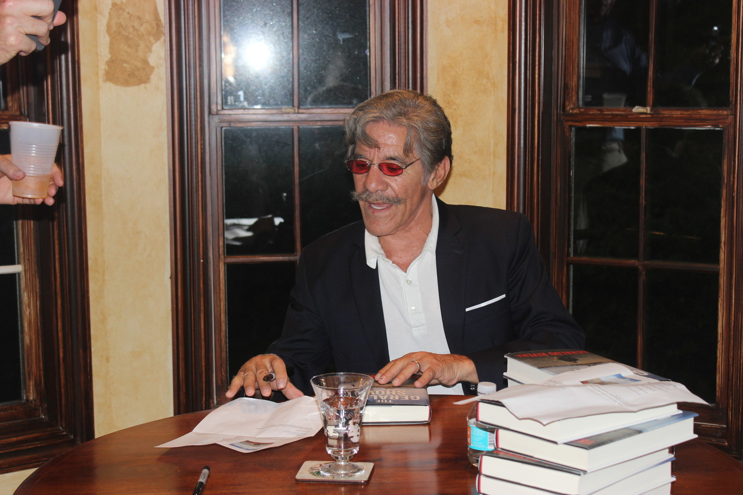 "Longtime journalist Geraldo Rivera signs copies of his new book, ""The Geraldo Show: A Memoir,"" at a private event hosted by Janet and Dale Westling at their house in Sawgrass Country Club on June 2."