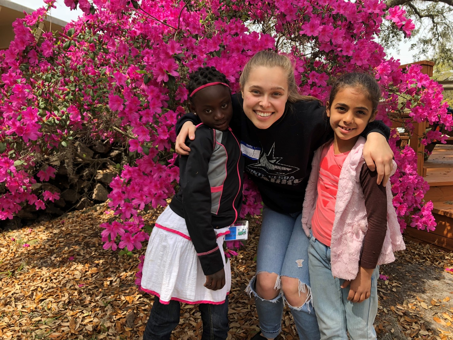 Grace Freedman poses with refugee students who are part of the JaxTHRIVE program.