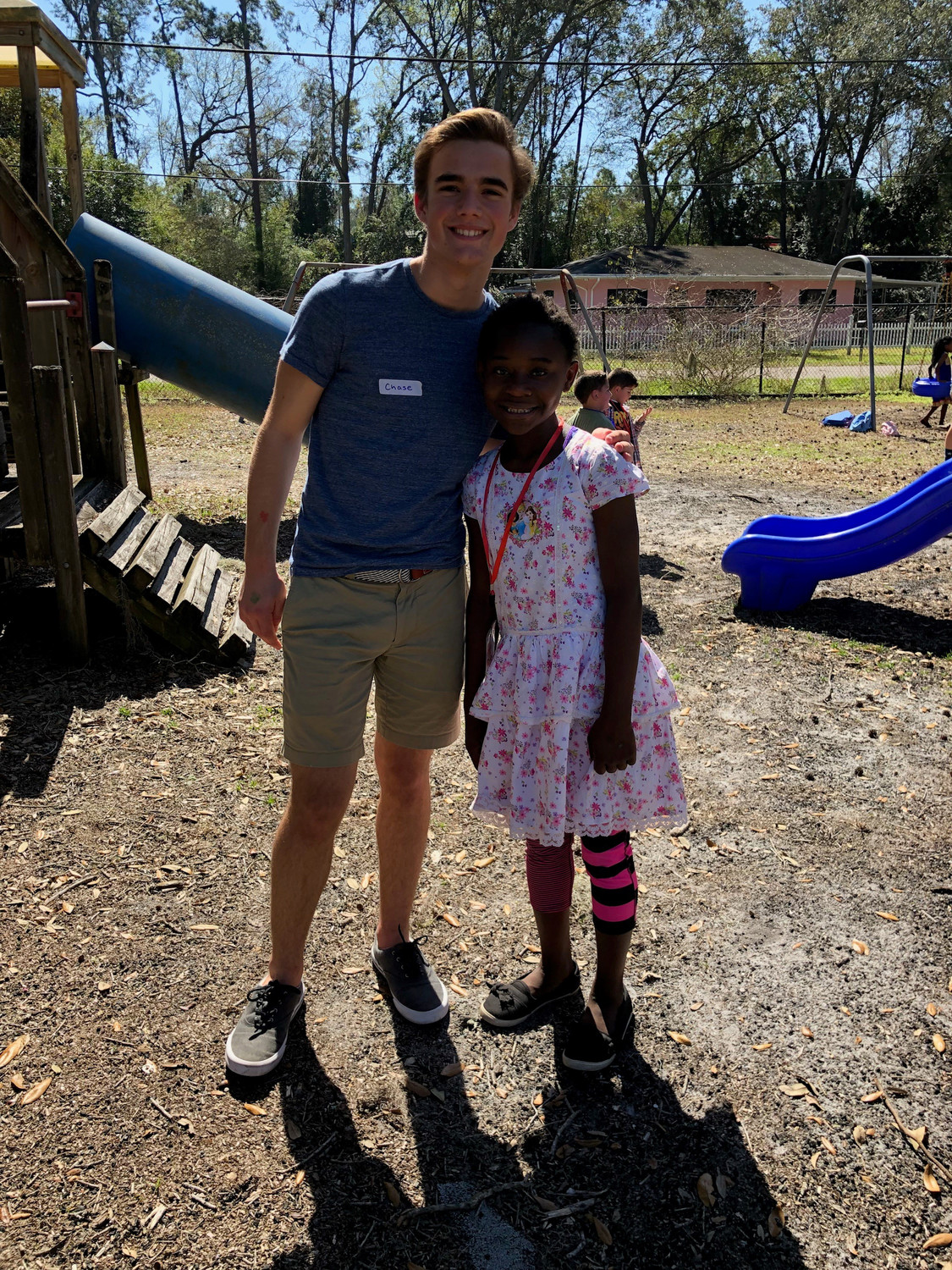 Chase Magnano poses with a refugee student at the JaxTHRIVE graduation party May 19.