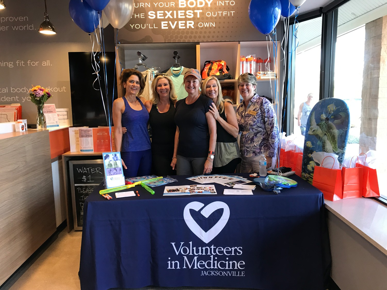 2017 Women With Heart honoree Aimee Boggs (from left); 2018 honorees Shelley Morgan, Leslie Gordon and Dany Atkinson; and Volunteers in Medicine CEO Mary Pat Corrigan attend one of the Orangetheory Fitness Charity Burn events.