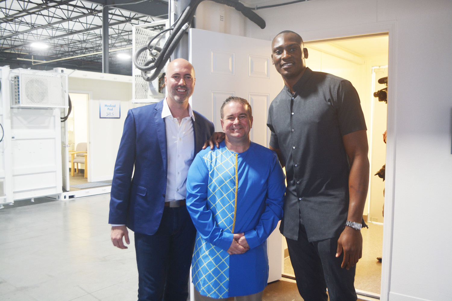 MATTER President Quenton Marty, Modular Life Solutions CEO Doug Recker and Orlando Magic player Bismack Biyombo gather April 13 at a fundraising event in Jacksonville benefiting a medical project that Biyombo is leading in the Congo.