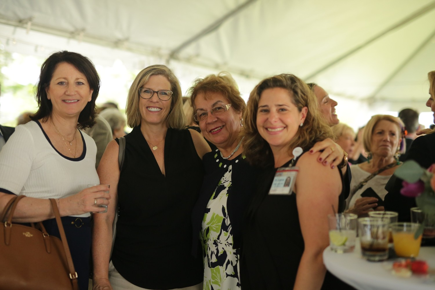 Rita Malie and Kelli Coughlin of the Tom Coughlin Jay Fund with Helena Gutirrez, LSW and Amanda Lochrie, PhD of Nemours