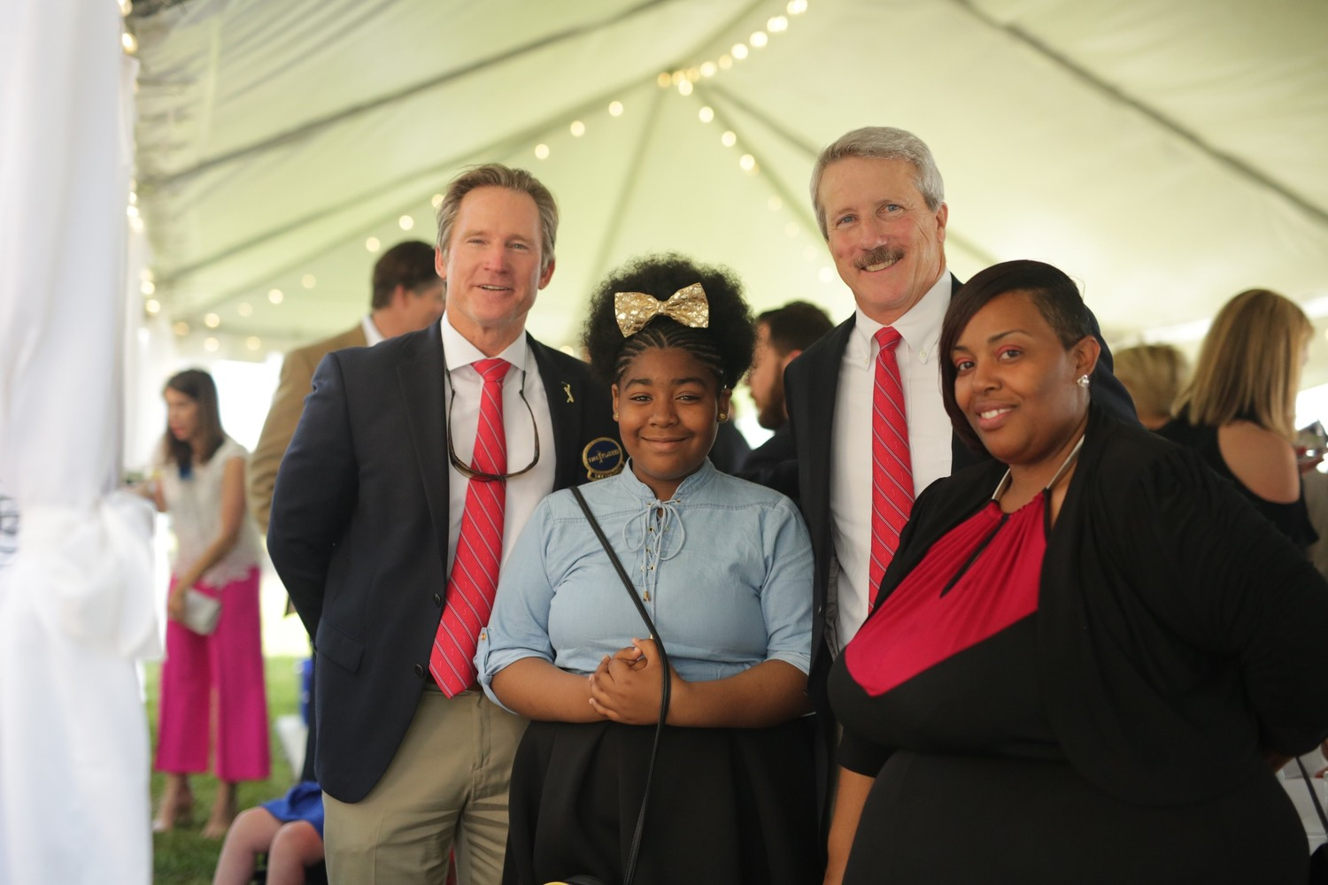 Troy Smith and Matt Welch of THE PLAYERS Championship with Azaryah and her mom Arzra MacNeal