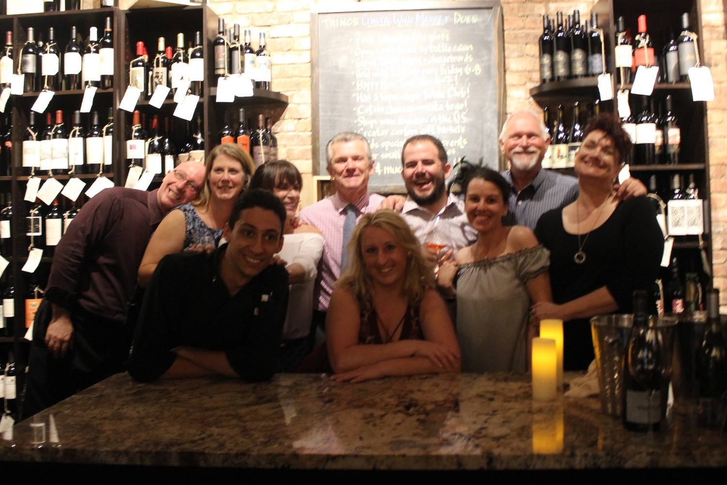 Julian Hardy, Michelle Hawk, Chef Jimmy Coffey, Shirley Mahoney, Dennis Mahoney, Michelle Liddy, Steve Lourie, Shaun Lourie, Allen Horne and Beth Leitter gather at the second anniversary celebration of Coastal Wine Market & Tasting Room on June 16.