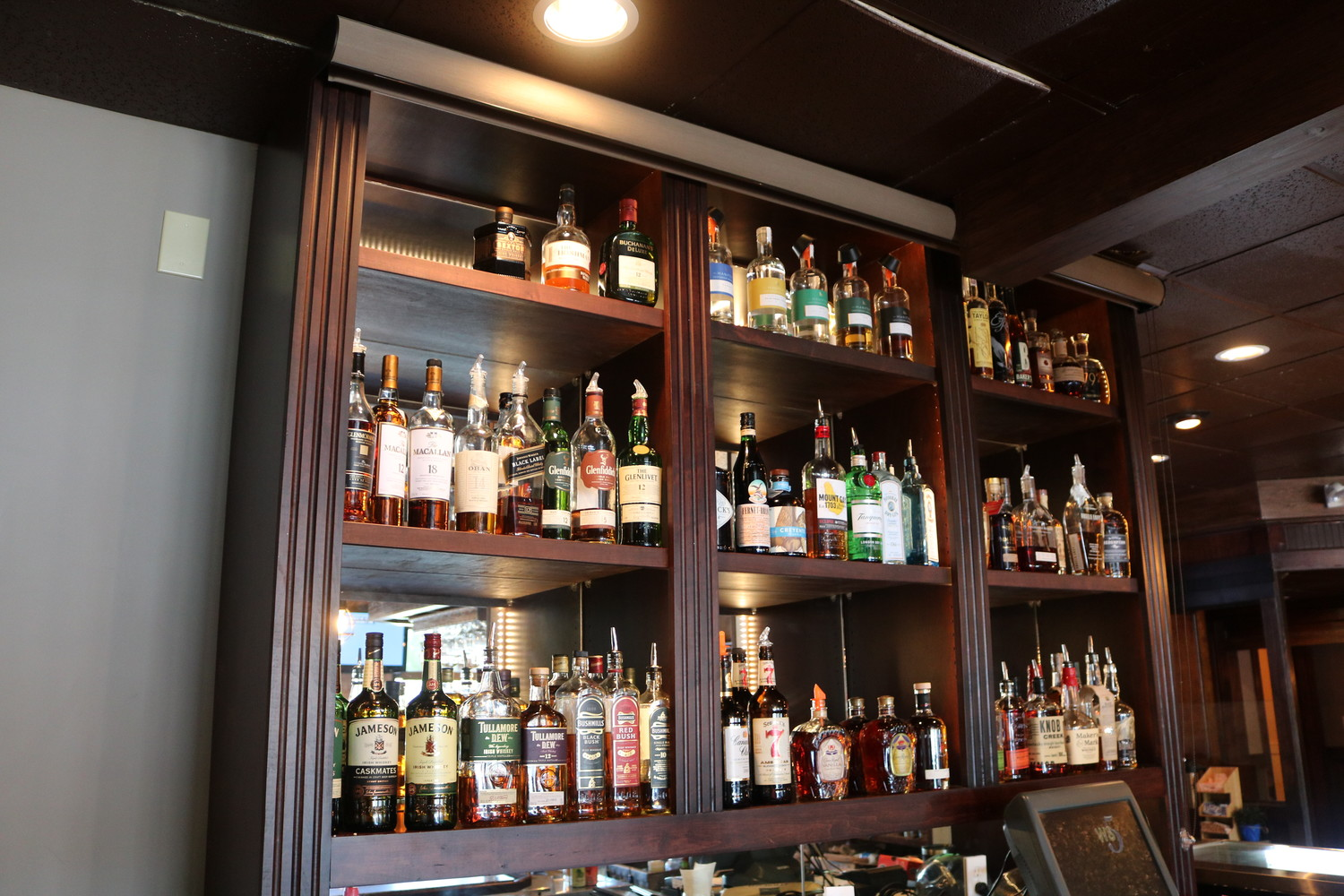 Guests can enjoy several liquor brands at Mulligan's Pub and make their choice by scanning a display featuring an assortment of options.