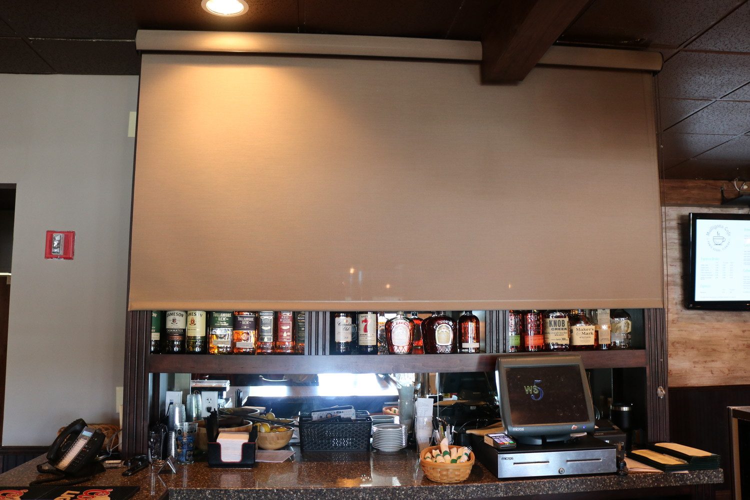 A covering hides the liquor display for breakfast guests, which helps add a morning atmosphere for a.m. customers.