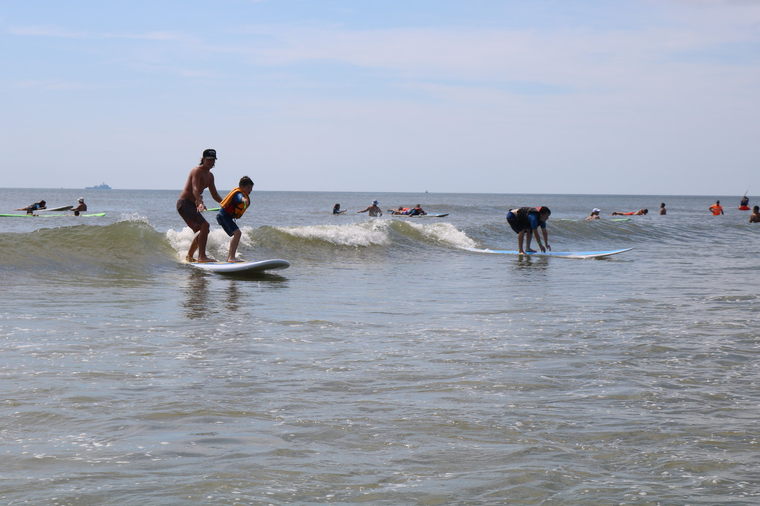 Local children and young adults with autism and related disabilities surf at the HEAL Foundation's 13th annual surf camp held June 26-27 in Neptune Beach.