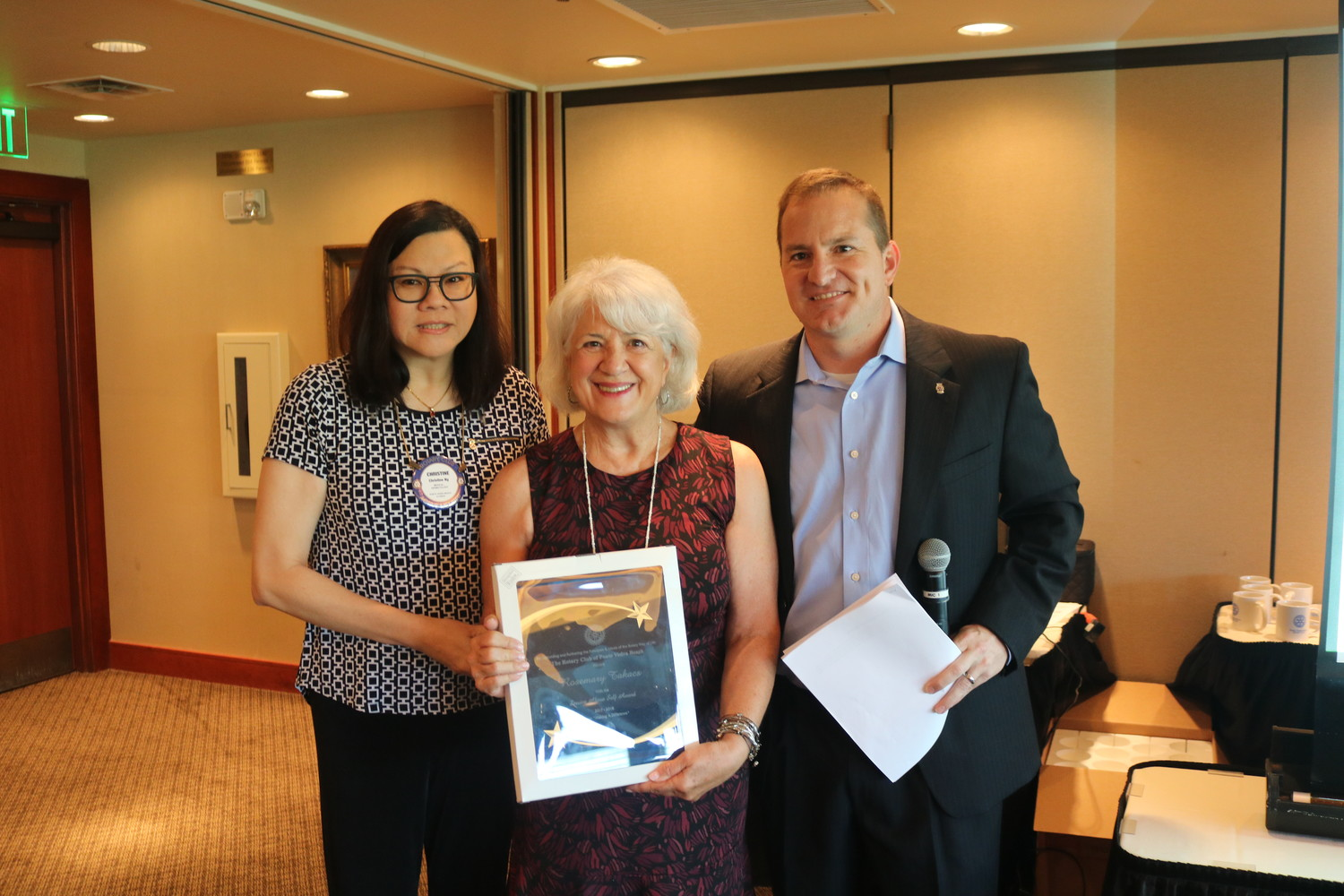 Rosemary Takacs (center) receives the Service Above Self Award from Christine Ng (left) and Billy Wagner (right).