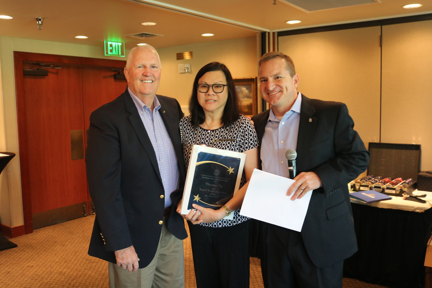 Christine Ng (center) receives the Don Blackburn Award from Bruce Barber (left) and Billy Wagner (right).