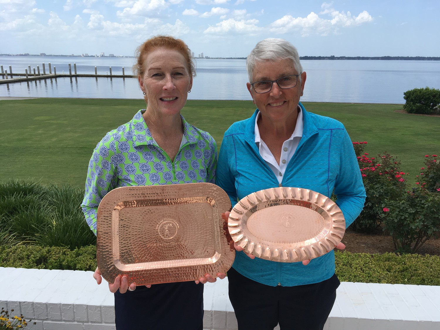 First Coast Women's Amateur Championship Senior Division winner Tama Caldabaugh (left) and Super Senior winner Carol Williams