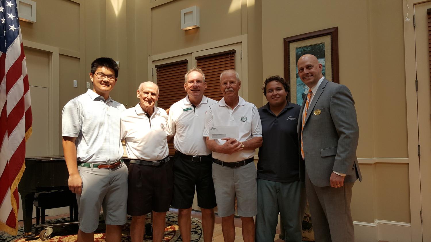 Leadership from Sawgrass Country Club presented Jacksonville Area Golf Association (JAGA) with a check donation of $12,800 for the nonprofit's scholarship trust last Monday, June 25 at JAGA's June meeting. Displayed in the photo are JAGA scholar Sam Ohno (from left), JAGA Directors Ray Gottschalk, Gregg Deiboldt, and Ken Hicks, JAGA scholar Emilio Mirabilio and Sawgrass Country Club General Manager C.W. Cook.