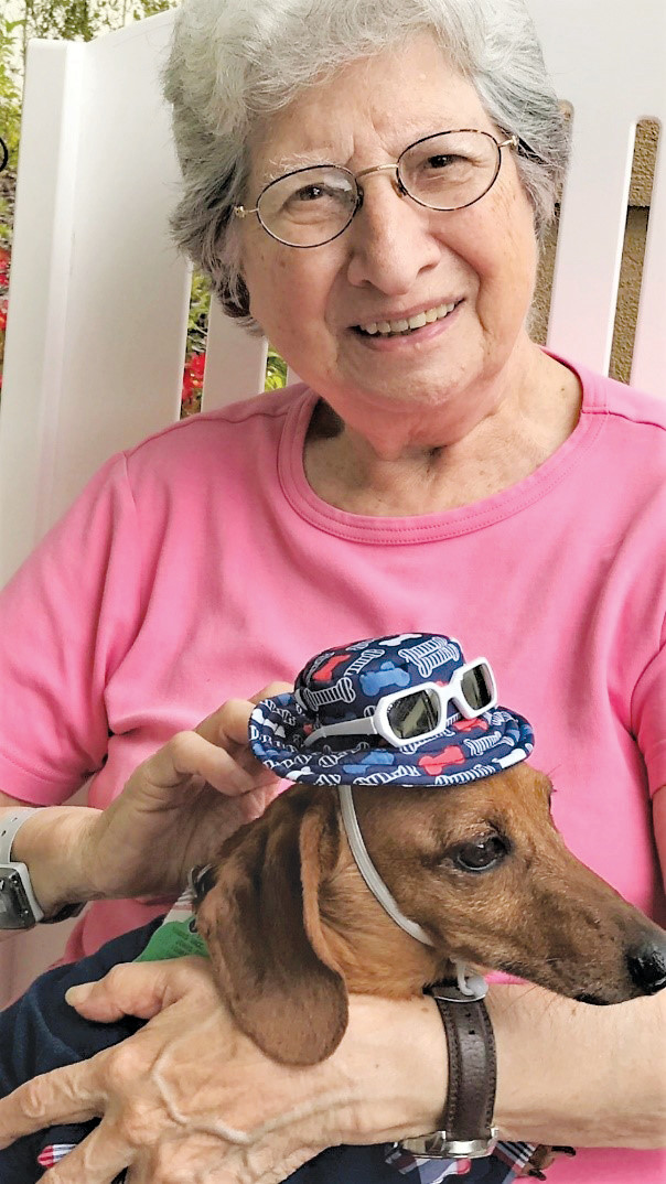 "A Silver Creek resident snuggles with a rescue dog named Chevy. Others will have similar opportunities July 26 when Silver Creek hosts its ""Yappy Hour"" adoption event in partnership with S.A.F.E. Pet Rescue."