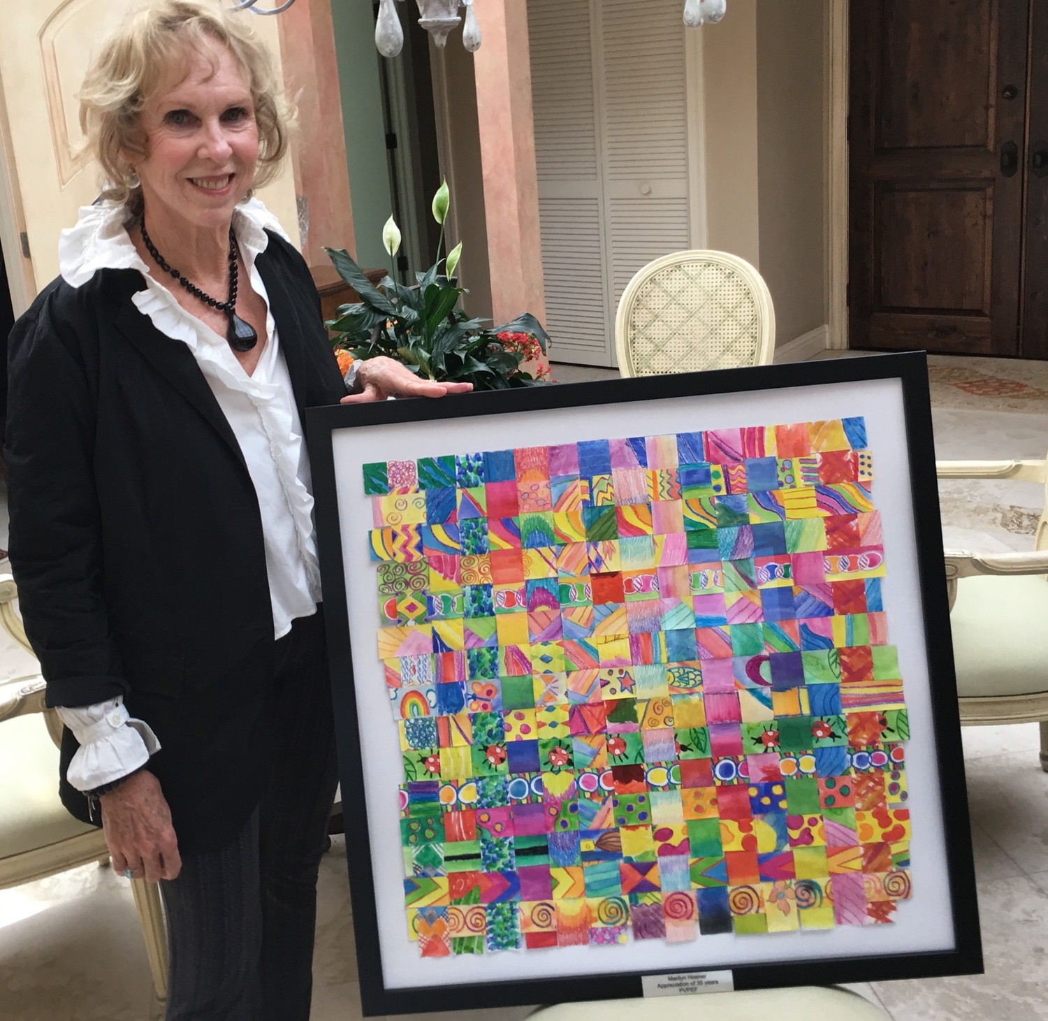 "Marilyn Hoener poses with ""The Thank You Art"" artwork created by Ocean Palms Elementary students that was given to Hoener to thank her for 35 years of service with PVPEF."