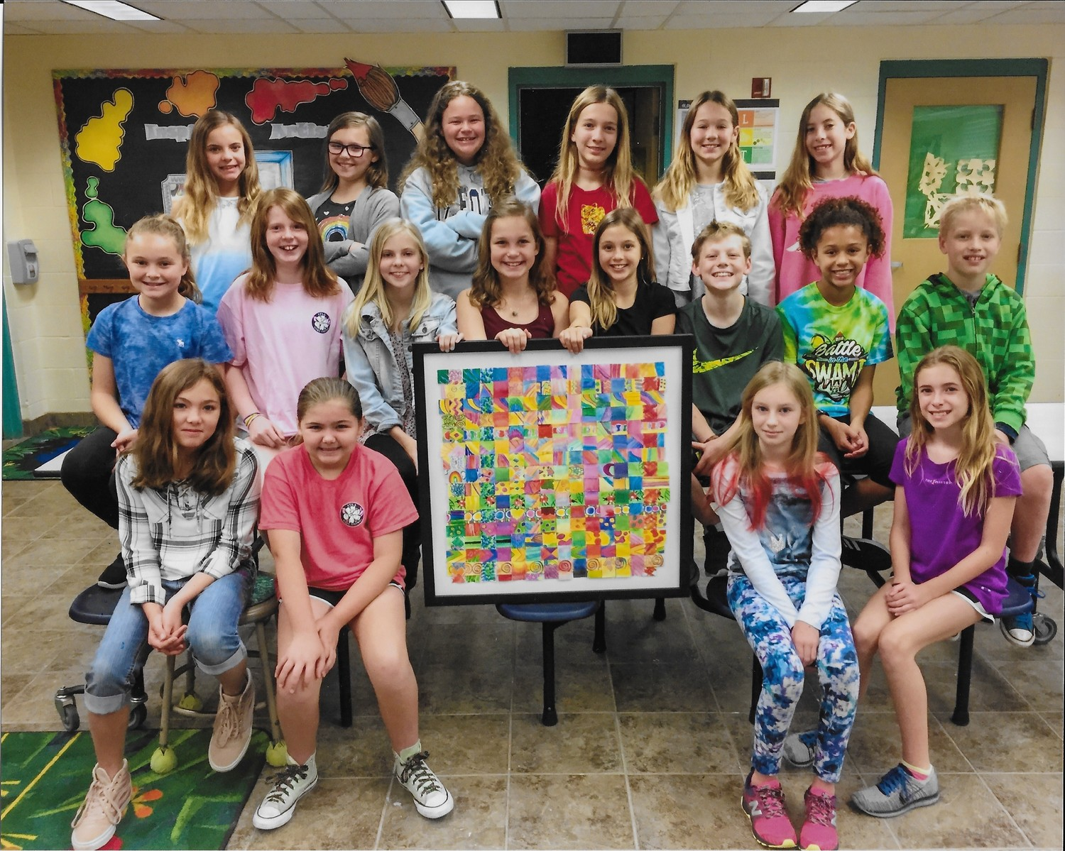 Ocean Palms Elementary students display the work of art they created as a thank you to the Ponte Vedra Public Education Foundation.
