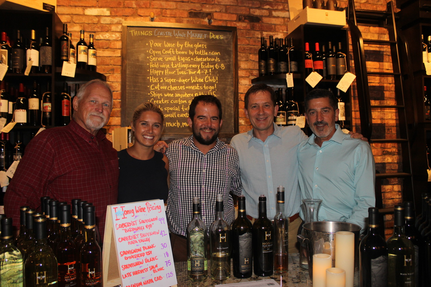 "Allen Horne, Mary Luckett, Steve Lourie, Michael Honig and Tony Tirello gather at Coastal Wine Market & Tasting Room's ""Meet the Winemaker"" event July 10."