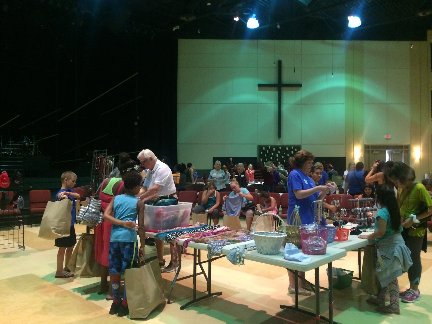 Volunteers assist Beaches families as they browse through items at the Back to School with BEAM event Aug. 4 at Beach Church.