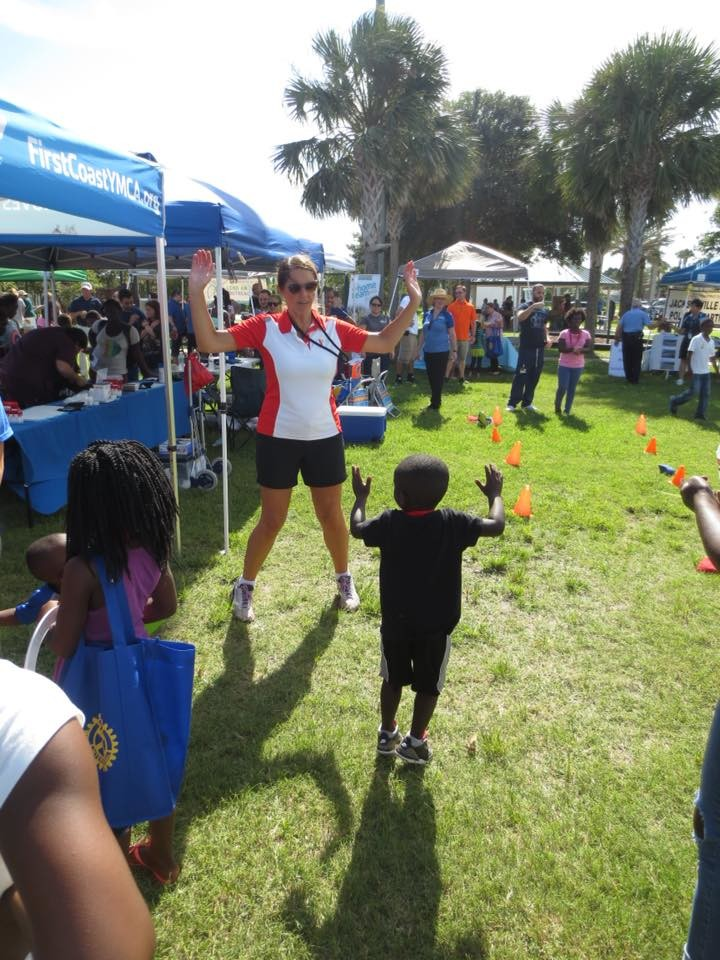 Ponte Vedra YMCA Executive Director Jennifer Ryan teaches kids how to do jumping jacks.