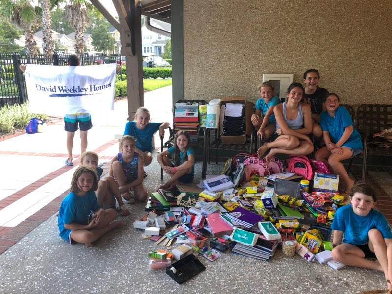 "The Girls Group of Twenty Mile in Nocatee organizes collections July 29 for the David Weekley Homes CARE program's ""Show that you CARE"" back-to-school supply drive benefitting Investing in Kids (INK!) with School Board member Kelly Barrera."
