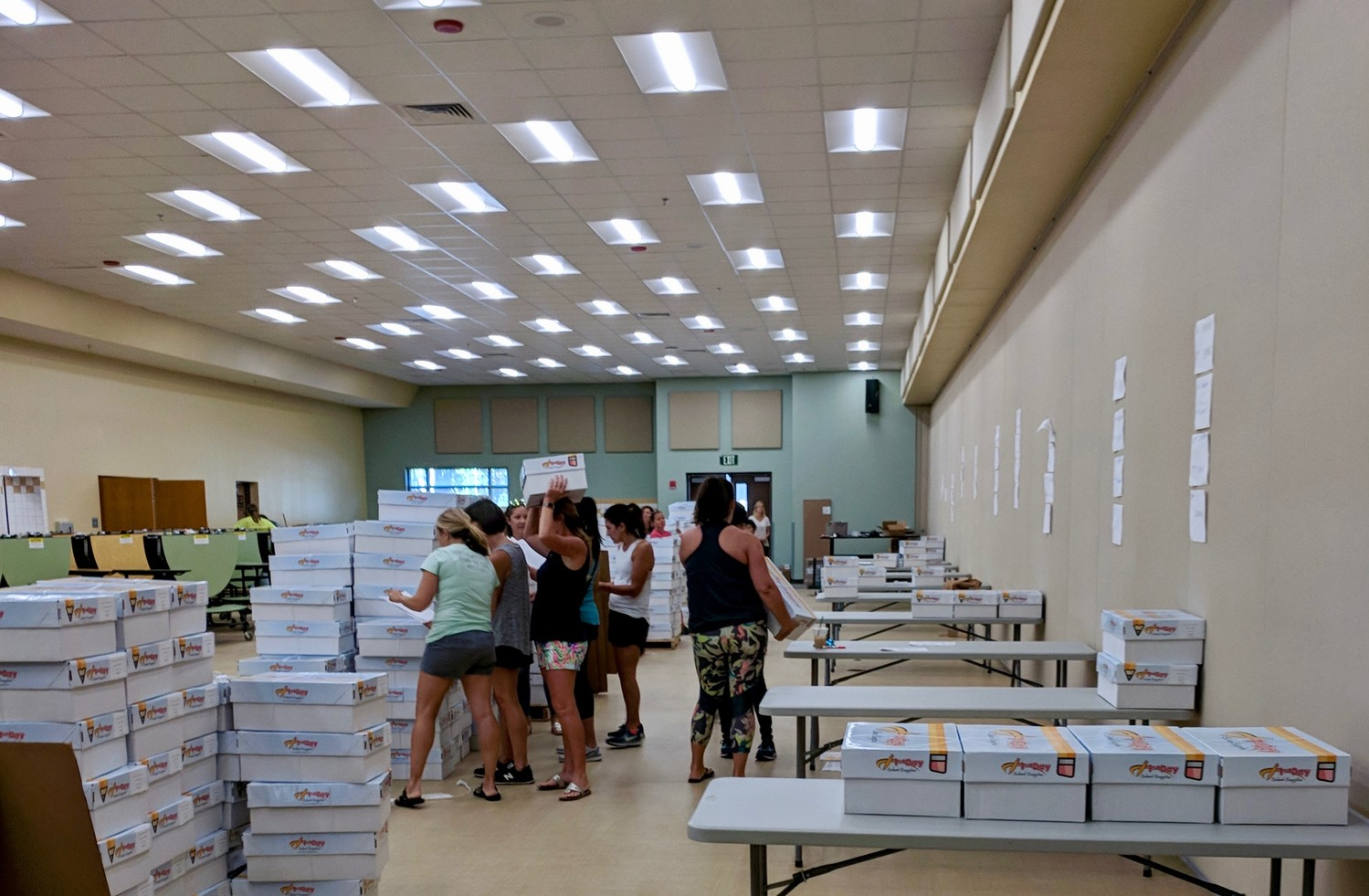 Volunteers and members of the Palm Valley Academy PTO sort and prepare school supplies.