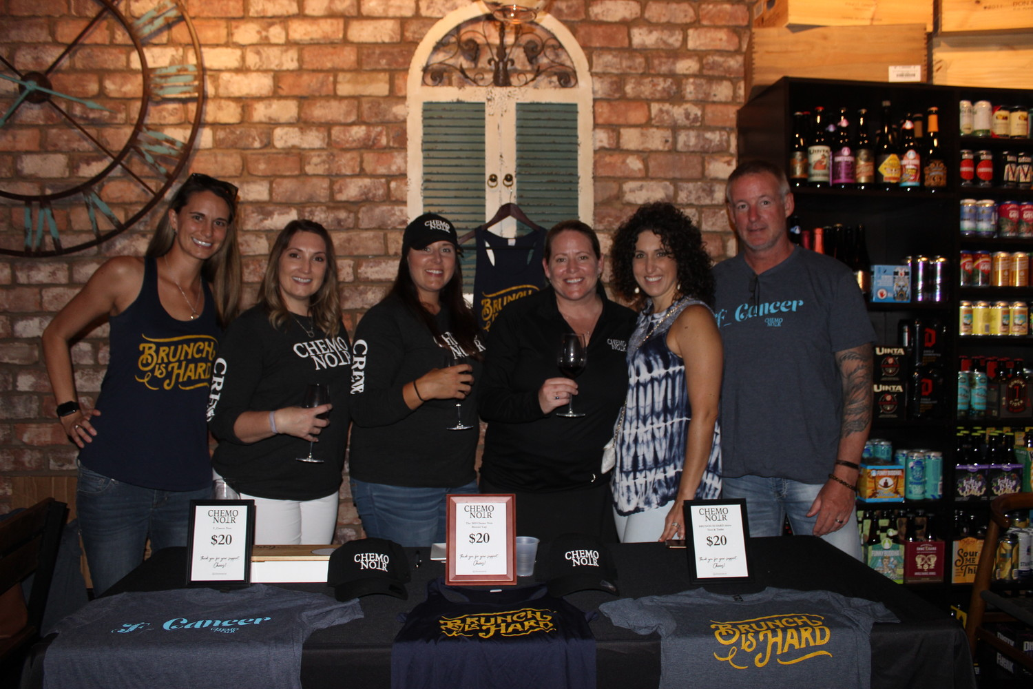 Wendy Alexaitis, Amy Shopp, Shannon Largin, Katrin Casey, Nicole Bickford and Bill Bickford gather at the CRUSH Cancer event at Coastal Wine Market Aug. 18.