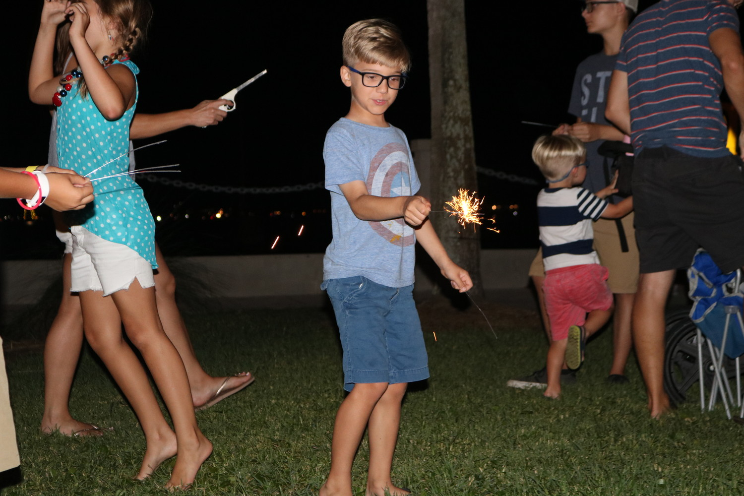 A family plays with sparklers after the fireworks concluded.