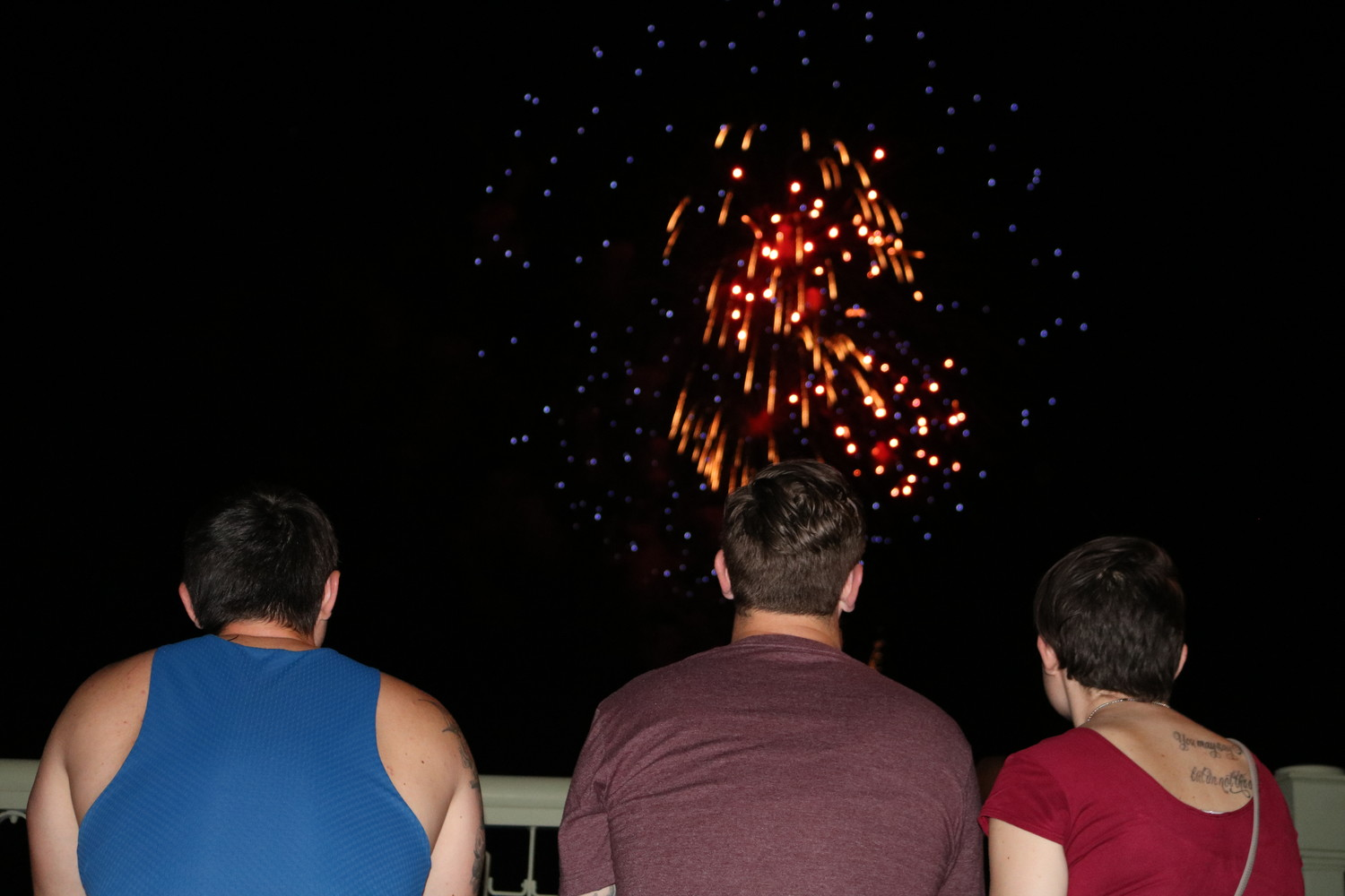 A group of people enjoys the fireworks show in downtown St. Augustine.
