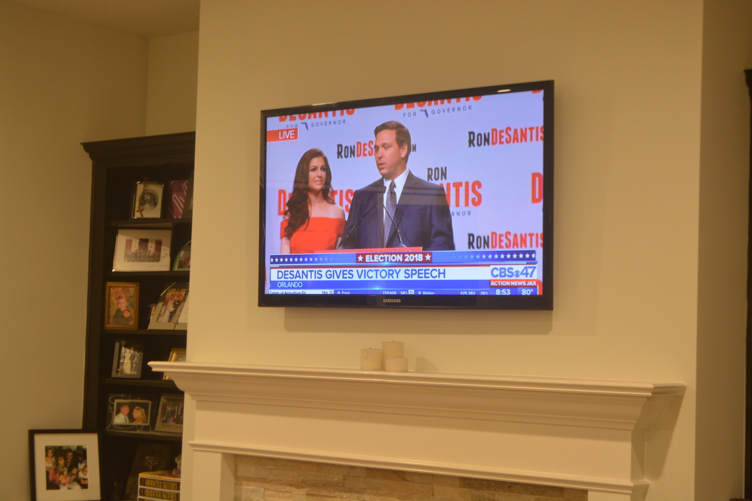 A television at Jeremiah Blocker's home shows Ron DeSantis' victory speech.