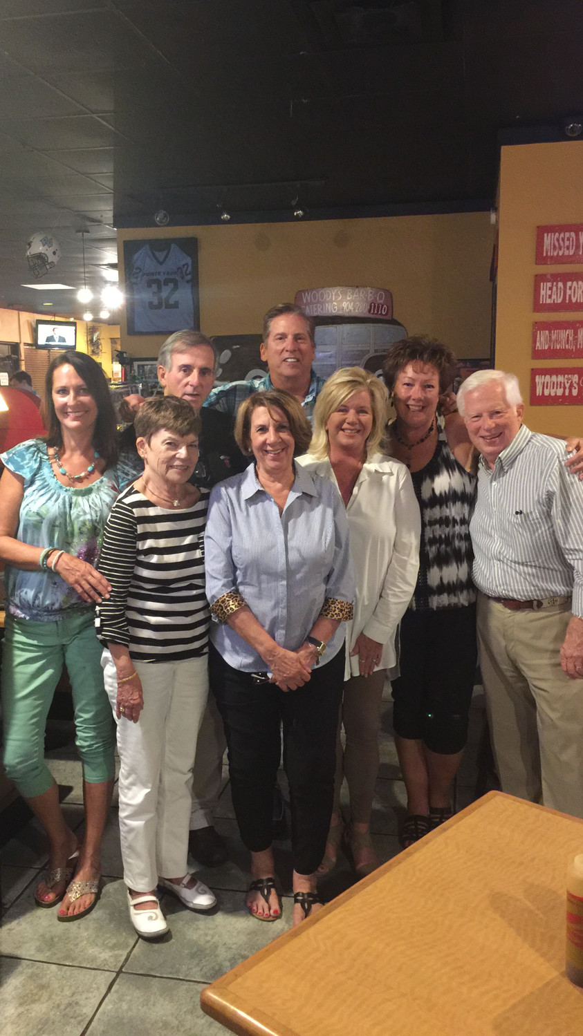 Gary Jurenovich (center, back) gathers with supporters at Woodys Bar-BQ on Tuesday night after winning Seat 1 of the Municipal Service District of Ponte Vedra Beach.
