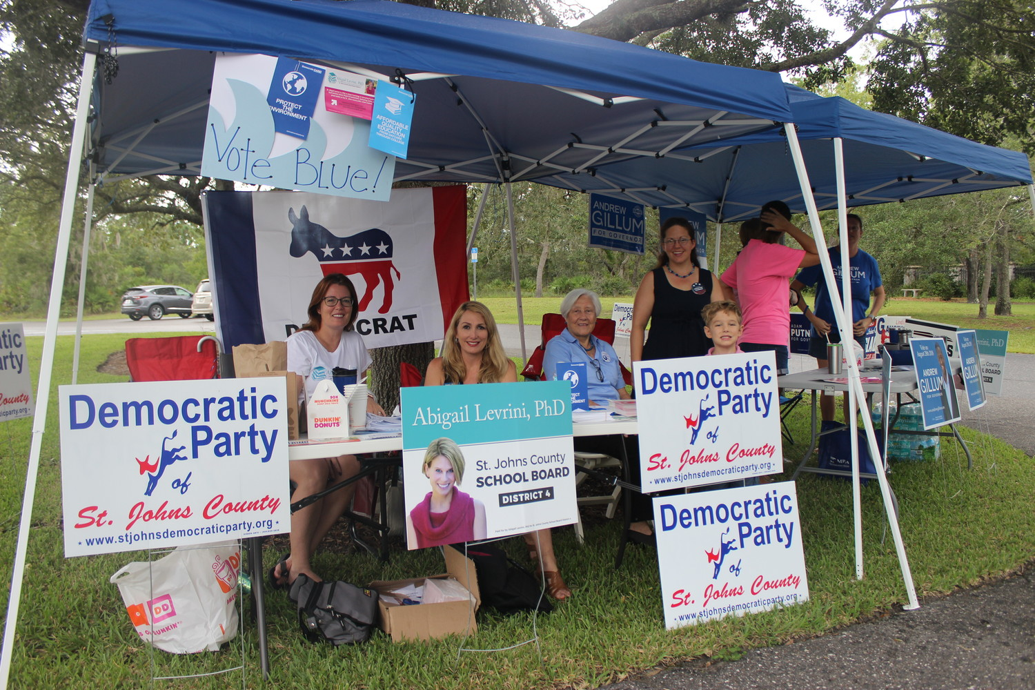 Members of the local Democratic Party gather Tuesday at Precinct 406 at St. Francis in the Field.