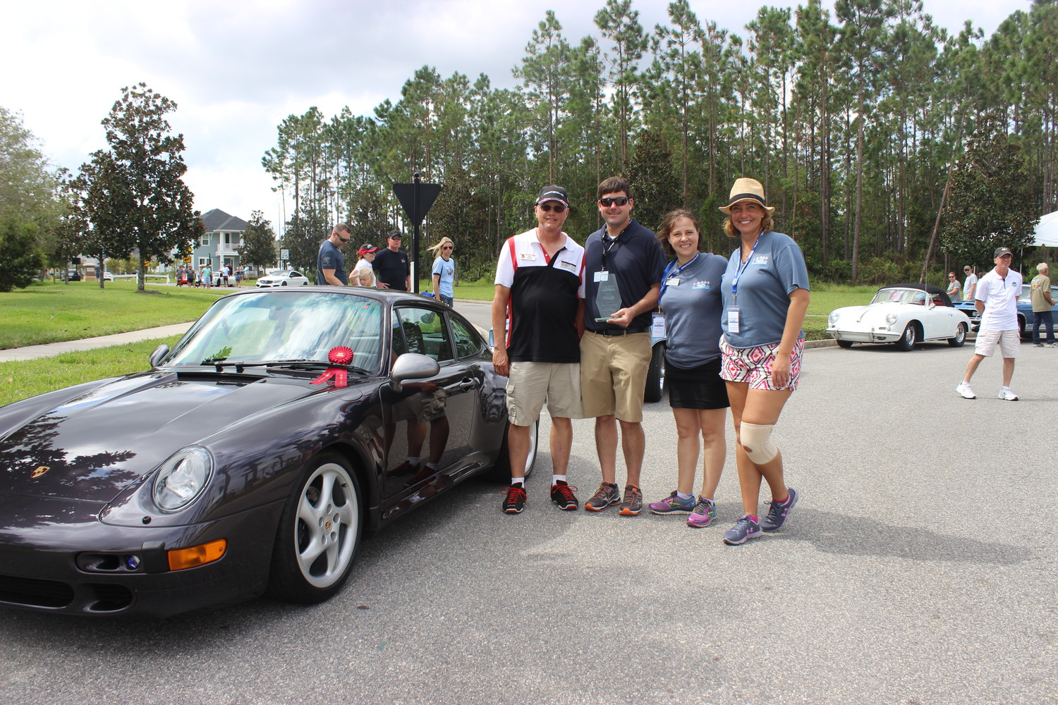 "Rob Sewell's 1997 Porsche Carrera S wins the 2017 ""Porsche For the Spirit of It!"" award. Pictured from left: Sewell, Porsche Jacksonville General Manager Brandon Starks, St. Johns County Chamber of Commerce Ponte Vedra Beach Division President and CEO Isabelle Renault and Chamber Director Toni Boudreaux."