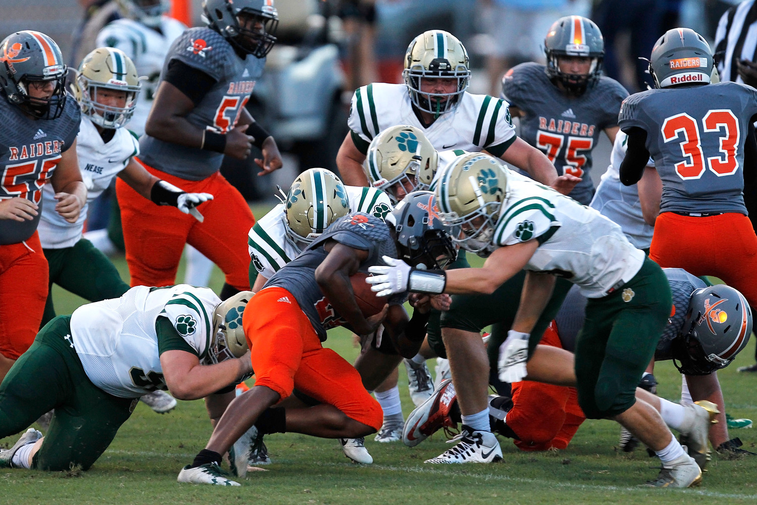 The Nease defense combines to bring down the Orange Park ball carrier.