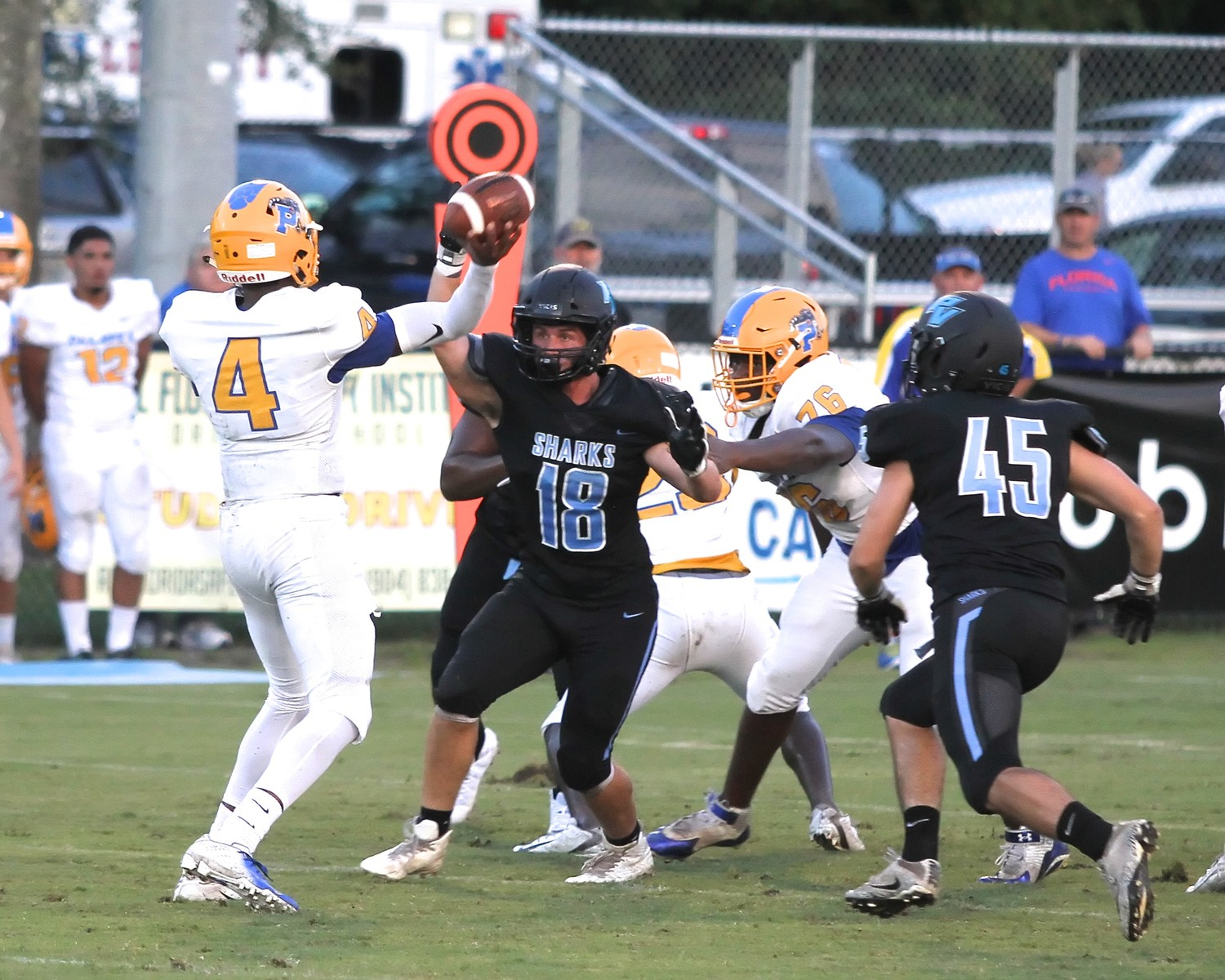 Ponte Vedra defensive lineman Peter Merlini puts pressure on Palatka's quarterback during the Sharks' 39-26 win over the Panthers.