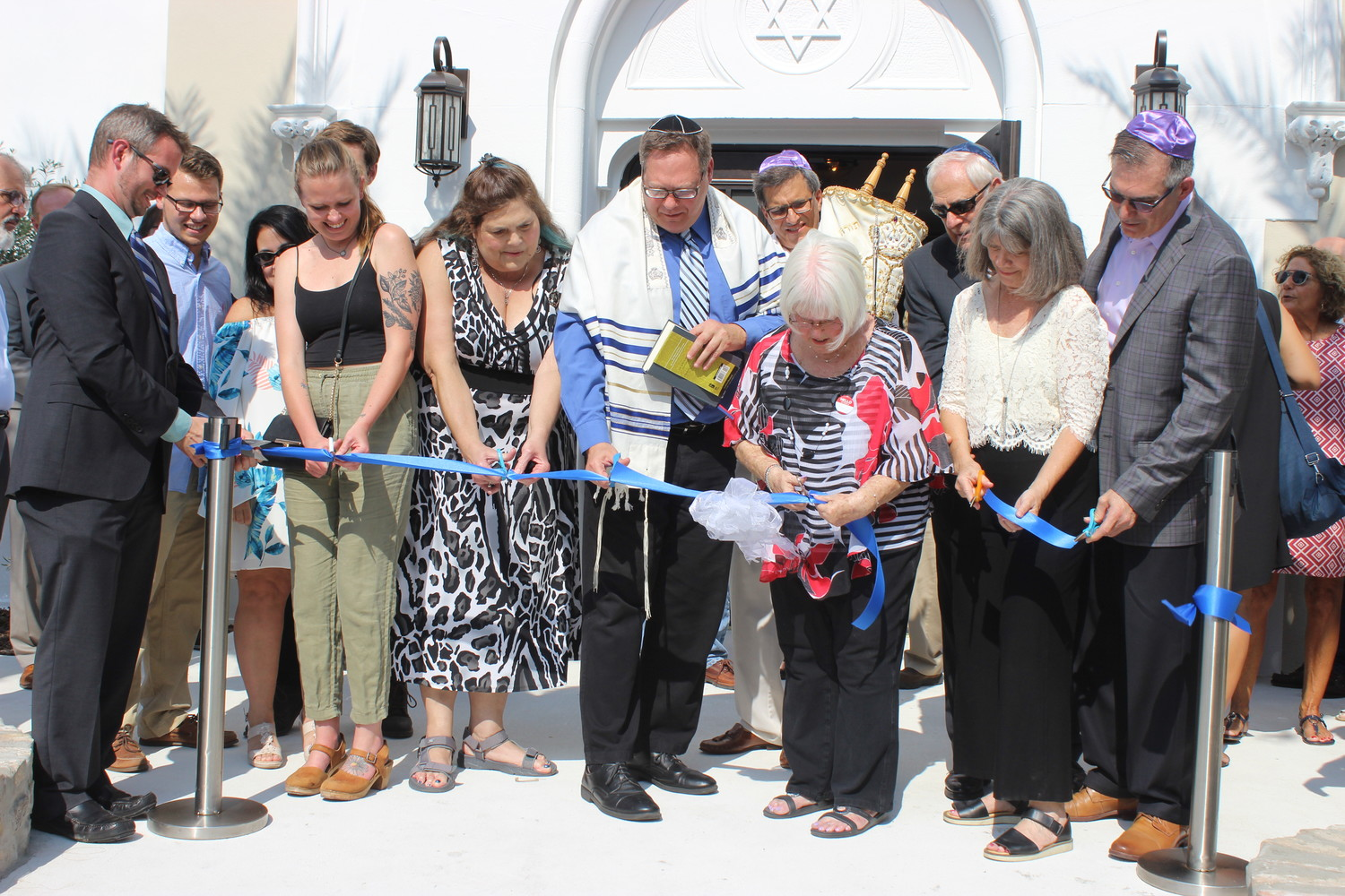 Members of First Congregation Sons of Israel in St. Augustine participate in a ribbon cutting ceremony on Aug. 24 in celebration of the reopening of its sanctuary after 22 months of repairs following Hurricanes Matthew and Irma.