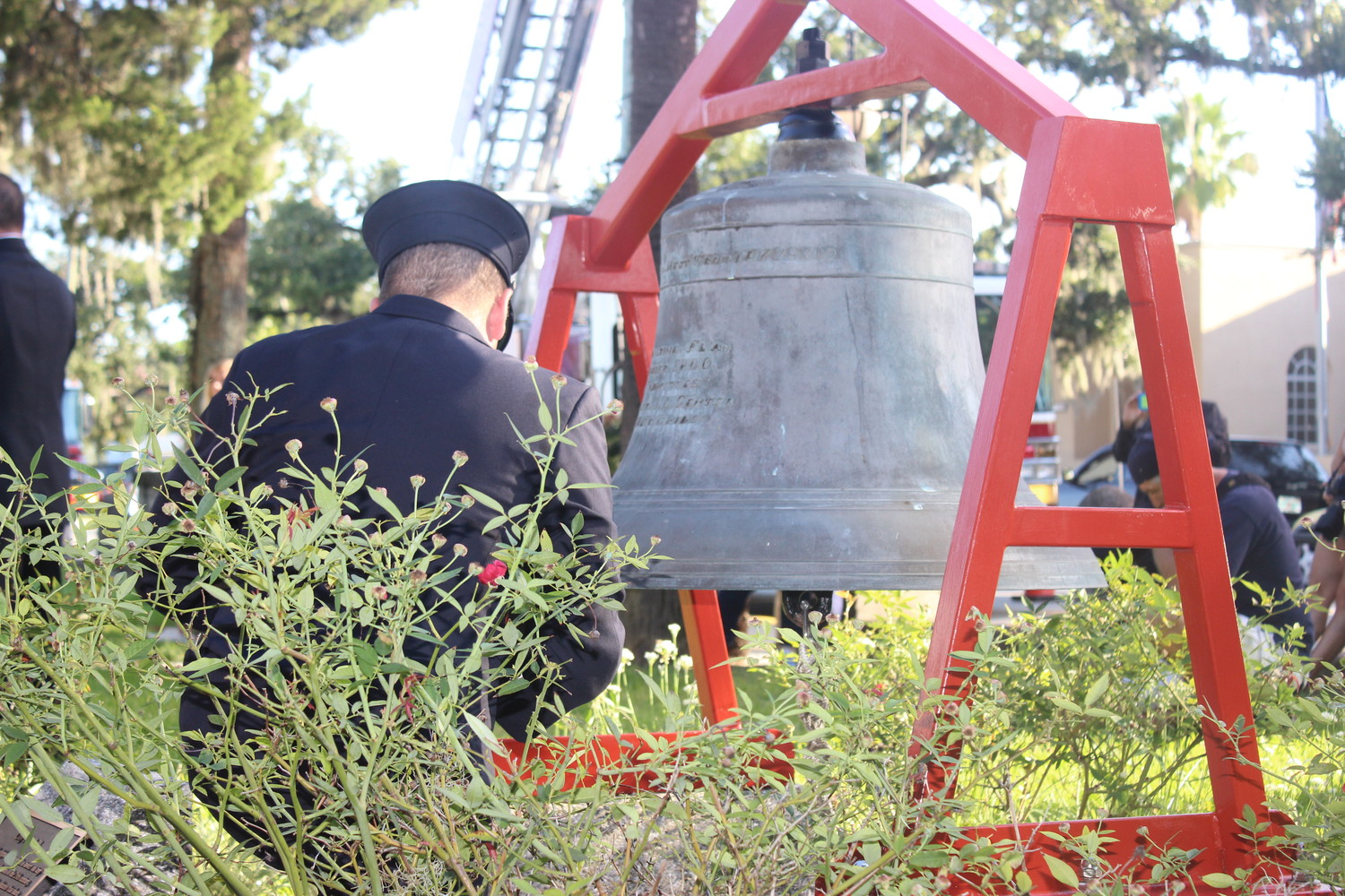 A firefighter with the St. Augustine Fire Department rings a historic bell to honor the first responders and civilians who lost their lives on 9/11.