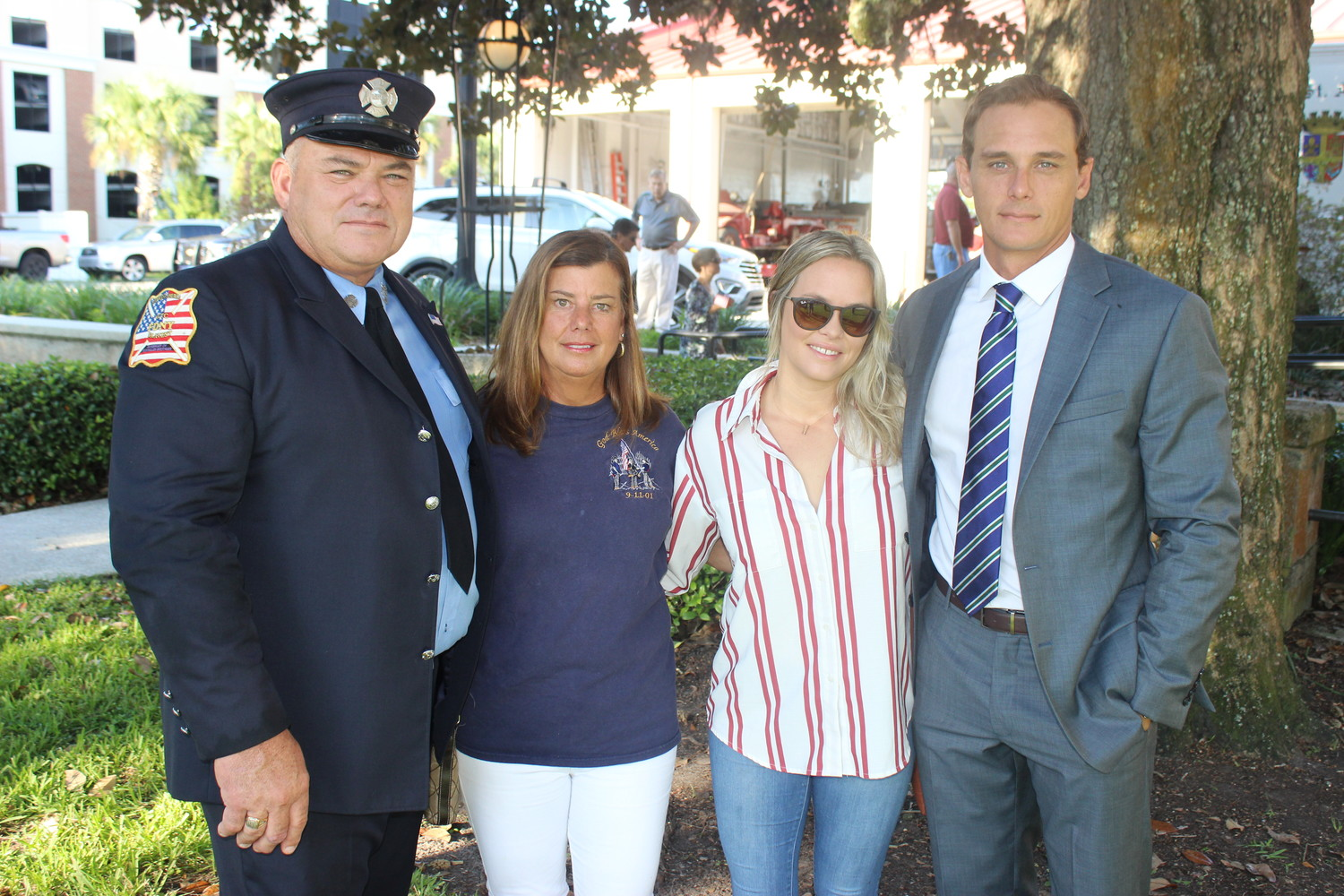 John Westfield (left), a retired FDNY firefighter who responded to the 9/11 attacks, gathers with his family after speaking at a special ceremony held Tuesday in St. Augustine to remember those lost 17 years ago. Westfield and his family now live in St. Augustine.