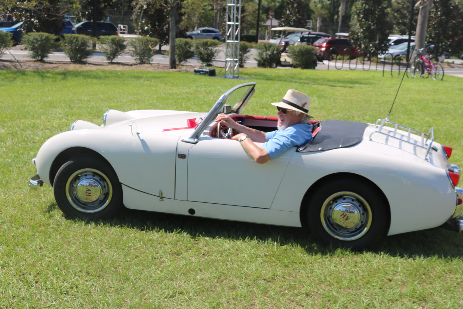 Bill Young parades his 1960 Austin-Healey Bugeye, which was awarded the Best in Show 60th Anniversary of Austin- Healey sponsored by Meehan's Irish Pub.