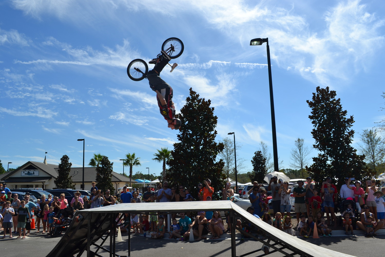 A member of the Perfection on Wheels BMX Pros Trick Team performs a stunt in front of a crowd of onlookers at the Nocatee Farmers Market last Saturday, Sept. 15. The show included half-pipe tricks and stunts, crowd participation and more. Per the usual, the Farmers Market also included over 70 local vendors offering items such as organic produce, herbs, spices, unique foods, crafts and jewelry.